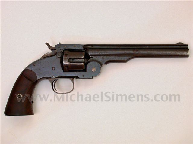 FIRST MODEL SCHOFIELD REVOLVER MADE BY SMITH & WESSON.