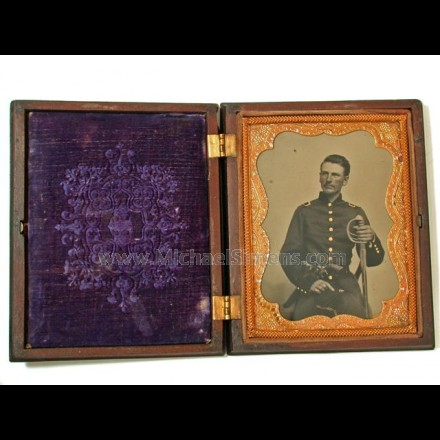 CIVIL WAR TINTYPE OF UNION OFFICER WITH A HOLSTERED SQUARE-BACK NAVY REVOLVER